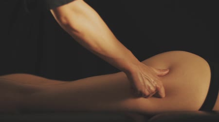 masaj : Concept of massage. Beautiful young woman gets a relaxing massage