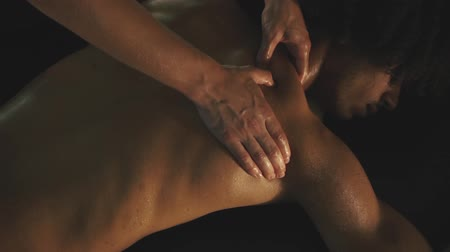 laying : Man relaxing with massage at spa