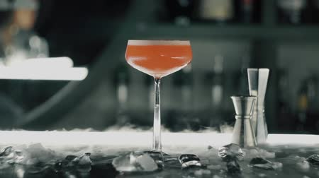 barman : Red cocktail on the bar