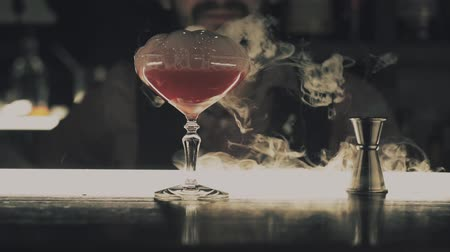 テキーラ : Halloween cocktail with dry ice at the bar 動画素材
