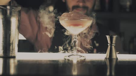 ginástico : Barman make a cocktail on a bar