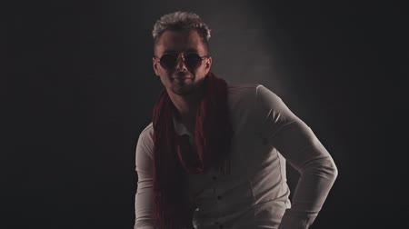 богатый : Fun man in a red scarf on a dark background