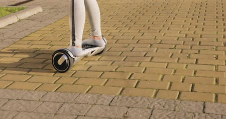 gyroscope : Female, girl without shoes ride on hoverboard, gyroscooter and turning.