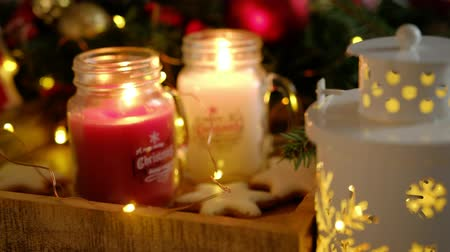 Two burning candles in beautiful decorative Christmas jars Wideo