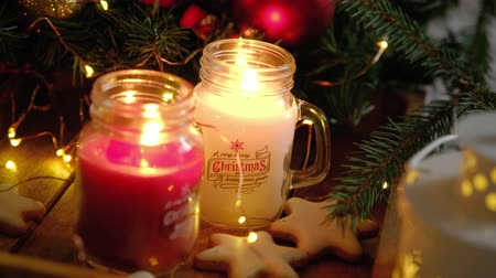 önemsiz şey : Two bright beautiful burning Christmas candles in glass jars