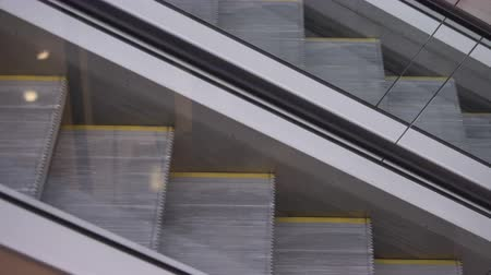 enduring : Movement up and down the escalator.
