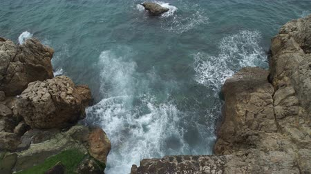 bordas : Upper view sea with waves breaking and frothing on a rocky beach.Seaside with big stones on the Cote dAzur
