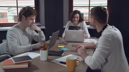 small businessman : Casual business team discussing project in modern office. Young and creative people with happy friendly smile sitting at the working place. Professional colleagues enjoy working day. Meeting startup company.