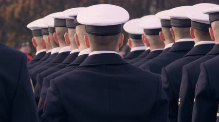 commando : Soldiers in blue uniform and white beautiful caps, holding a gun and standing in a line. At the awards ceremony Stock Footage