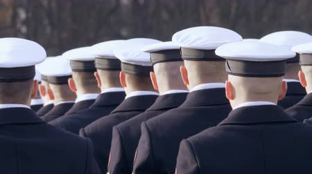 commando : White caps are dressed for soldiers, stand in line and look at the commander. video 4k Stock Footage