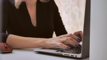 without face : close up girl works on pc. business details unrecognizable woman typing on laptop Stock Footage