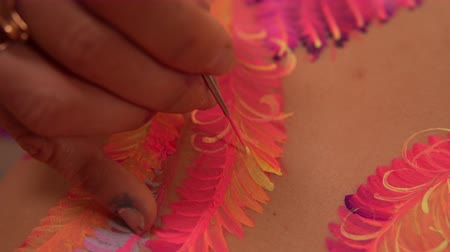 fuksja : Painting process of the floral wings. Body art on girls body