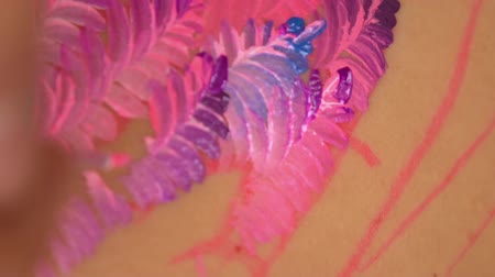 greatness : Colorful smears on womans skin. Detailed picture on the back. Stock Footage