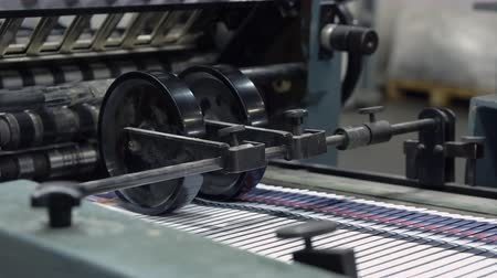 enrolado : equipment print factory conveyor belt in a printing press Stock Footage