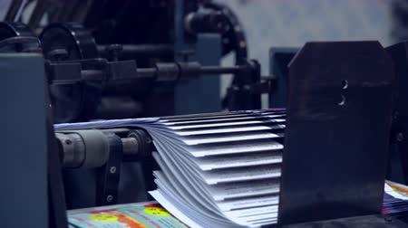 daily : newspaper moving on conveyor belt Stock Footage