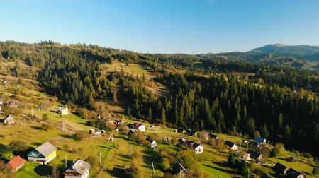 aerial drone shot rural landscape mountains village in autumn season Стоковые видеозаписи