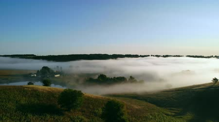 aerial view on countryside landscape with lake and and forest in morning fog autumn season nature