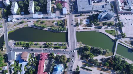 top view on the urban town contaminate with harmful substances river with green water road with driving cars Стоковые видеозаписи