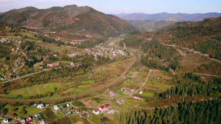 drone flying under village in mountains autumn season beautiful nature landscape in day time Ukraine Carpathians