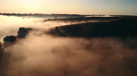 aerial view on the land and scenery of a rural area covered with mist