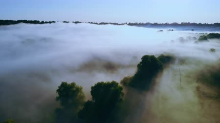 drone flying over foggy field early morning in the countryside
