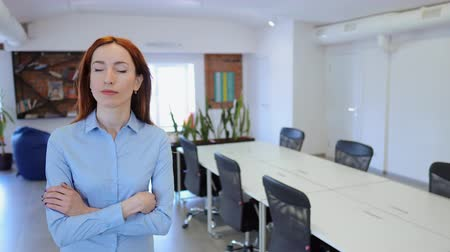 Woman walking confidently through co-working space. Young successful businesswoman walking in office hall.
