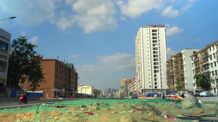 Residential quarter on a hot sunny day. Cityscape view of Hainan Island.
