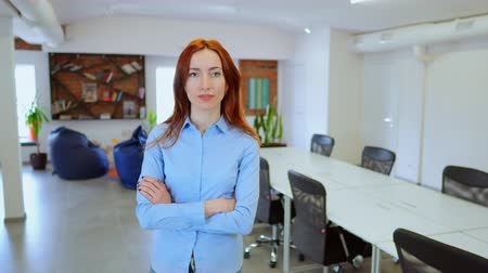 Strong independent woman in co-working space. Successful businesswoman crossing her arms.