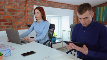Coworkers within modern stylish office interior. Footage of serious young people working.