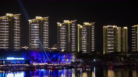 Riverside bay bridge panorama. Night illumination of Sanya streets. Стоковые видеозаписи