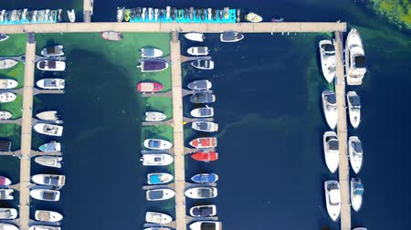 Top view of the boats within Sanya harbour. Sailboats moored in bay in Hainan Island.