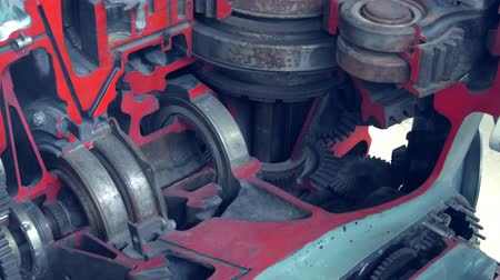 interlock : Closeup View Of Engine Gears Whell. Mechanism. Factory.Grey And Red Colours.Moving. Stock Footage