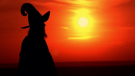 upward : halloween concept sorceress wearing fancy dress and hat offers a magic apple view on the sky with upward sun Stock Footage