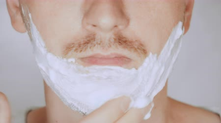 shaving foam : details lower face blond male preparation before shaving