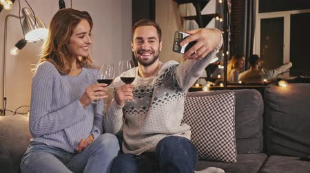video making : Happy lovely couple making selfie on smartphone while spending romantic evening together at home Stock Footage