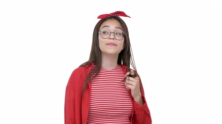 saç bantı : Cute dreamy young girl in red shirt winding hair on her finger while looking at the camera over white background isolated