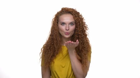nagelstudio : Attractive young redhead curly woman blowing a kiss to the camera over white background isolated Stockvideo