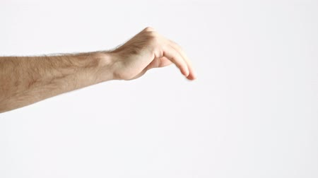 close cropped : Cropped view of man showing wave motion with hand over white background isolated Stock Footage