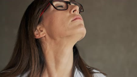 flat head : Cropped view of tired pretty young business woman closing eyes and stretching her neck because of pain while working on laptop indoors at home Stock Footage