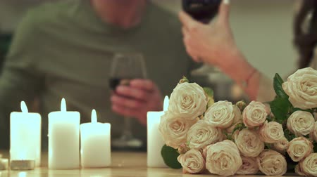 słoneczko : Happy couple in love clinking glasses and drinking Wine On Romantic Date at home Wideo
