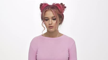 depleted : A displeased young woman with the colored pink hairstyle rolls her eyes isolated over white background Stock Footage