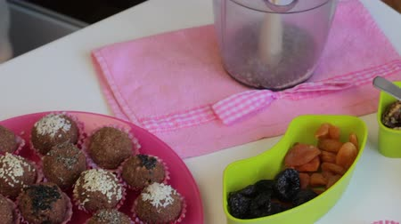 yermantarı : Homemade sweets on a plate. Next to the ingredients for their preparation.
