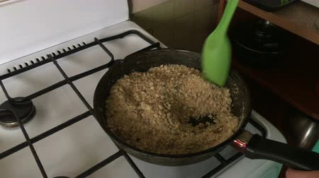 egg laying : Woman fry biscuit crumbs. Cooking a cake of biscuit crumbs and milk jelly.