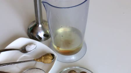 majonez : Cooking mayonnaise. Quail eggs in the bowl of the blender. Nearby are other ingredients.