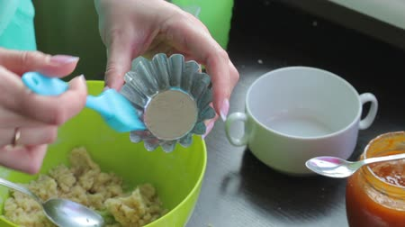 dyes : Woman lubricates pastry baking dish with butter. Other ingredients stand on the table. Stock Footage