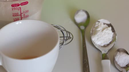 kneads : Ingredients and tools for making marshmallow sandwiches lie on the table. Stock Footage