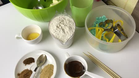 Gingerbread cookie ingredients are laid out on the table. Also tools for its preparation. Dostupné videozáznamy