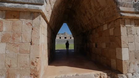 pyramida : girl walks among the Mayan ruins, uxmal