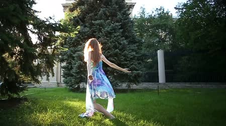 improvised : Young graceful ballerina dancing in the city park. The concept of modern dance. Performance. Stock Footage