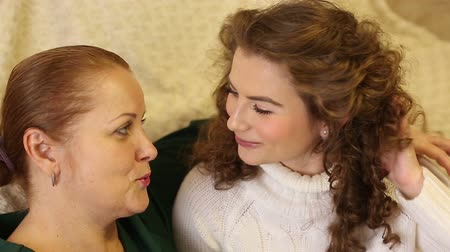 yapıştırma : Mother and daughter are intimate conversation. Gossip. Home gatherings. Family relationships. Home comfort.